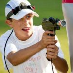 Kid aiming Laser Gun