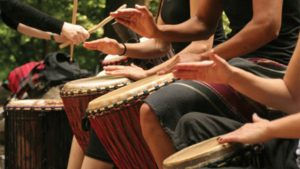 Drumming circle with hands on drum
