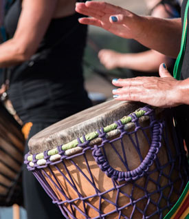 Close up of hands during traditional drumming session