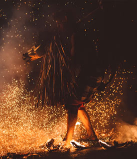Person walking over hot coals for fire walking
